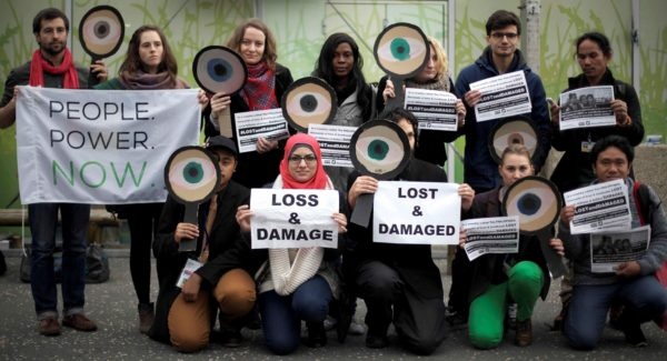 Friends of the Earth International call for wealthier nations to live up to their obligations to compensate poorer countries for loss and damage. COP21, December 2015. Photo: Friends of the Earth International / Luka Tomac